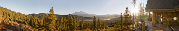 massive panoramic view of Mt Shasta and Lake Siskiyou from a large log cabin deck